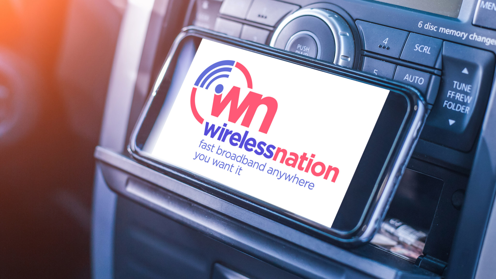WN logo on smartphone in car holder
